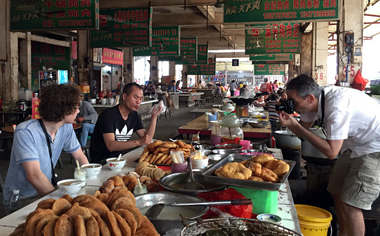 Try the local food at local market with local people.