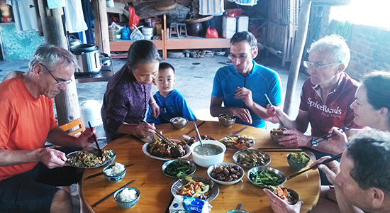 Lunch at local farmer's house when cycling in China.