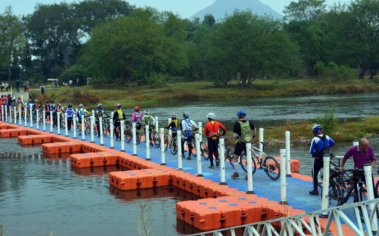 Cycling on the green way for bike above Li River